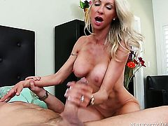 Blonde exotic Emma Starr with big knockers and smooth bush is in need of sexual pleasure after handjob