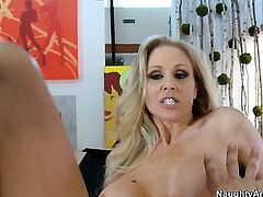Blonde tart with giant breasts and clean bush knows no limits when it comes to cock stroking