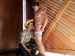 This movie is more than just sucking and fucking, with a plot and storyline. Here, Markie gets a little undressed while he is outside, being observed by Garrett. Garrett doesn't even take his hat off at first, as he starts blowing Markie!
