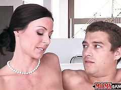 Brunette Kendra Lust with gigantic knockers and hairless muff offers her love box to hot dude in int