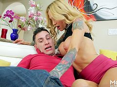 Sarah saw her son's friend sitting on the couch and made her move. The tattooed milf pulled out his cock and firmly gripped it, as she stroked him off. Watch as she deepthroats that big dick. She is a cock loving slut.
