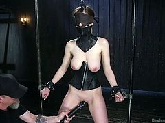 Stella is tied up and her legs and hands are restrained. She cannot see her executor, as she has been blindfolded, but feels the merciless guy's fingering her cunt. The man also uses a kinky vibrator to arouse this busty bitch. Enjoy!