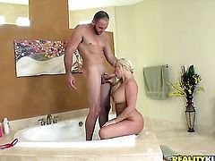 Blonde Julie Cash with gigantic tits and clean beaver gets pleasure with erect man meat in her mouth