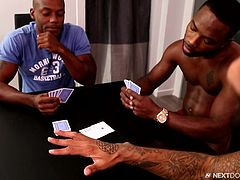 Three black guys were playing poker and the loser, has to suck winner's cock. Osiris Blade won the bet and ordered the remaining two, to suck each other. After some time, he also became horny and joined the session. Watching big black cocks in gay threesome surely make your cock rock hard.