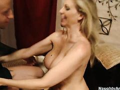 Blonde Julia Ann with big boobs and bald twat does her best to make man ejaculate using nothing but her sexy warm hands
