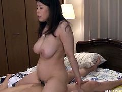 Mizuno was on honeymoon with new husband. Her husband was eager to play with her big boobs. He spanked her ass and stimulated her cunt. She got aroused and asked him to drill her asshole. After that, he fingered her and fucked her pussy from behind.