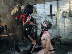 Mike wanted a woman, who would dominate him hardcore, and he got all that plus some evil, when he met Lily. The satanic slut whips him in her dungeon, having some device strapped on his head as well. He does what she tells him, like a good slave should.