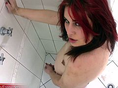This redhead tranny has a pretty face and a plump body. Anita is dressed in her skimpy black lingerie with thigh high stockings on her shapely legs. She strips down everything but her stockings...