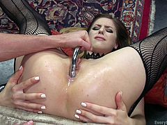 Ariel loves hot lesbian sex, and the only thing she likes as much as eating pussy, is eating ass. That's exactly what she does, after she uses a slender steel dildo and a big, fat one in her bunghole. Check out the muscular Ariel, as she works out Stella's behind.