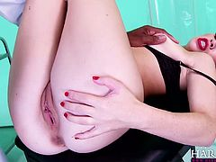 Sizzling hottie Tiffany Doll takes massive black dick in her anus on the gyno chair