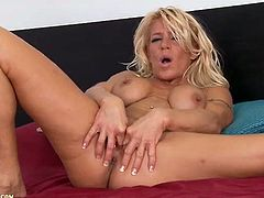 Vivacious blonde milf fingers her twat and ass