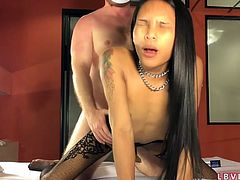 Flat-chested Thai ladyboy Pampam gives a POV blowjob and gets her slutty ass fucked bareback in doggy style.