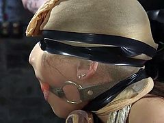Abella's executor doesn't play nice, tying her arms behind her, as they're stretched to their limits. She's gagged and has her face covered with pantyhose, then blinded by electrical tape, as he gets ready to put her in some pain.