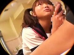 Alluring Japanese teen drops to her knees and worships a lo