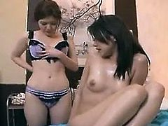 Striking masseuse seduces a gorgeous girl for a wild lesbia
