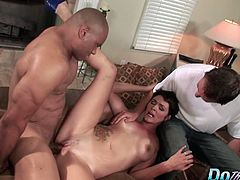 Hot house wife is brought to a porn set to show her husband how she can fucked another guy.  Her pussy stretches around the black guy's thick cock and she cums. Her pussy is so good that the guy blows his load into her and her husband gets to watch it drip out.