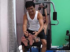 These ticklish boys just keep coming for a workout, and they surely get one This time Asian cutie Idol gets restrained to the gym equipment for a hearty tickle workout on every muscle of his Asian twink body. Ricky starts with feathering his cute little ticklish boy feet, making Idol giggle and wiggle like a school boy. Then he really gives it to him with his fingernails. Idols soft smooth soles are ticklish as fuck so Ricky spends most of his time tickling his flailing, thrashing feet.