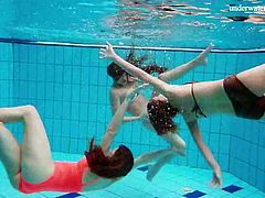 Three teen friends strip in the swimming pool