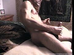 Already naked on the bed, Enrique quickly strokes up his monster cock. After I blow him for a while we start a cock fight and then he grabs my dick and starts to suck on it. Enrique strokes my load onto his cock then eating my own cum I go back down on him. He starts to moan and blasts his load.