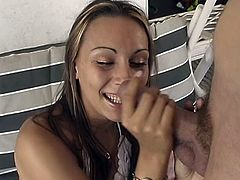 Horny hottie playing with a hard cock