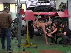 Susy wanted to repair her broken car, but she got into the hands of fraudsters. They caught her, tied her in ropes and decided to have fun. See her hanging in the middle of the garage and sucking some stranger's dick, while surrounding people film her on their phones. Have fun!