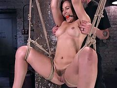 Just look at her, she is ready for any of your fantasies. This sensual, flexible babe is in your full disposal and only at your mercy. Hanging in the middle of the room, with ball gag in her mouth and wide open pussy, Dani is waiting only for your hard dick. Just come and join! Hot babe!