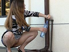 Samantha is outside on this warm day, and you can't blame her for that. Aside from the cameraman, she's alone, so those clothes come off quickly. She pours water from the bottle she filled over her huge tits, then squats down to play with her pussy.