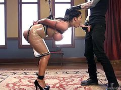 August Taylor, dressed in sexy latex dress, with her big boobs hanging out, was tied in the middle of the room, with her arms behind the back. Now she is going to take Owen's long dick first in her mouth, then, well lubricated with her own saliva, up her pussy. Watch breathtaking bdsm fantasy! Enjoy!