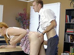 This school girl gave all her answers wrong and only her pussy could save her. Her dress made it easy to seduce the teacher. She bent down and exposed her round ass. He rubbed her butt and inserted fingers in her asshole. Then, he put her on the table edge and shoved his huge cock in her tight pussy.