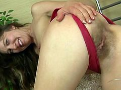 Pubic hair peaking out from behind her cotton panties