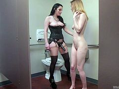 Veruca needed Pepper's tongue in her pussy right away, so they went to the bathroom together. She hiked up her leg and let her servant do her work. She's ready to penetrate that blonde beaver, so she gets her strap-on ready and has pepper slide down on it.