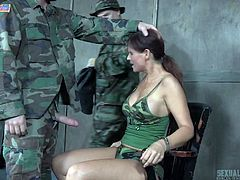 My team was failed to accomplish the covert mission, and I was captured by military. When I woke up, I found myself in an unknown place, tied to a chair, wearing just underwear. A soldier put his cock in my mouth and fucked my throat. He removed my bra and squeezed my big boobs.