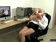 Audrey Argento is a wellendowed blonde sitting in on a teleconference at her office. taking a break, she dives a finger under her black panties to tickle her juicy clit. When her personal assistant sees she could use a hand or mouth or dick he dives in to lap up her love juices. She rides his pole on the rolling office chair and gets him off between her big tits.