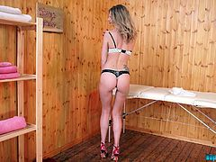 Hottie Leah strips and shows her yummy pussy in the massage parlor