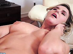 Blonde has fire in her eyes as she masturbates