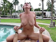 Visit official Titty Attack's HomepageNude brunette moans while being fucked by the pool in a very dirty manner, the guy pulling her hair and spanking her in between the sex scenes