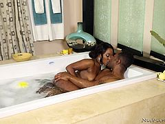She is so horny for her man's giant black cock. The naughty teen helps him take off his jeans and she is shocked by the size of his massive black dick. He is rock hard, as they rub each other covered in soap, and she wants him inside of her so bad. The hot ebony beauty gets fucked hard in the bubble bath.