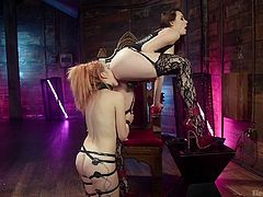 The horny brunette warned the redhead, by giving mild electric shocks and ordered to lick her pussy. To avoid further punishment, Amarna Miller licked her partner's wet cunt, giving special attention to peanut sized clit. To have a quick orgasm, the brunette put a vibrator on her...