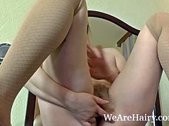 Gina Lin is finger banging her hairy pussy