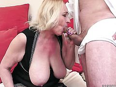 Mature with gigantic jugs finds man hot and takes his hard dick in her mouth