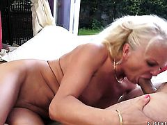 Blonde shows her love for pole sucking in blowjob action with hot guy