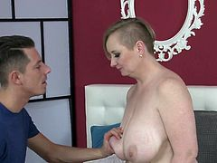 This mature blonde fell in love with the handsome stud and her lust was so intense, that she started sucking his cock, without even asking for his permission. The guy was on cloud nine while she was sucking his cock and he groped her big saggy tits.