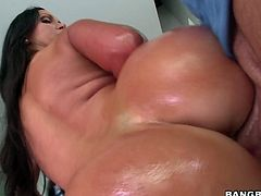 Oiled up ass of sexy bitch Nikki Benz looks fucking hot in cowgirl pose