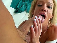 Hot bodied mature babe Raquel Sultra in black stockings and tiny panties gets her shaved milf pussy banged with her fake round tits out. This horny woman is hungry for fucking!