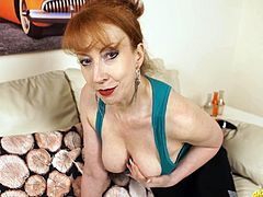 Old bitchy woman Red shows off her big natural boobs