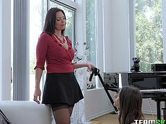 Mindi is a sultry, brunette dominatrix who knows how to introduce new sexy subs into the lesbian BDSM scene. Watch as she trains pretty Arielle by putting her on a leash, and instructs her to lick her stilettos. Arielle's mouth is then put to good use, when she licks and sucks Mindi's big tits.
