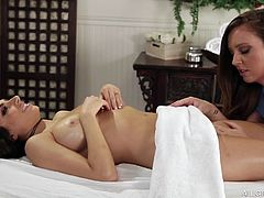 A nice relaxing massage is exactly what this beautiful lady needs. She gets a rub down from a beautiful masseuse, who opens up her legs and tries out that tasty cunt. Her pussy is dripping wet now as she receives cunnilingus.