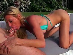 Leggy tight MILF babe Ceira Roberts with fake perfect boobs and tight clean shaved pussy gets her hole drilled outside with her barely their bikini top on. She is fucking horny!