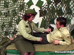 A redhead mature army officer reprimanding a young soldier by having him lick and fuck her pierced wet senior pussy while wearing her sexy stockings.