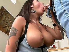 Brunette with some massive and saggy bazongas is going to give a great bj in this video. For working so hard, she'll get a nice cumshot at the end. Well deserved, girl!